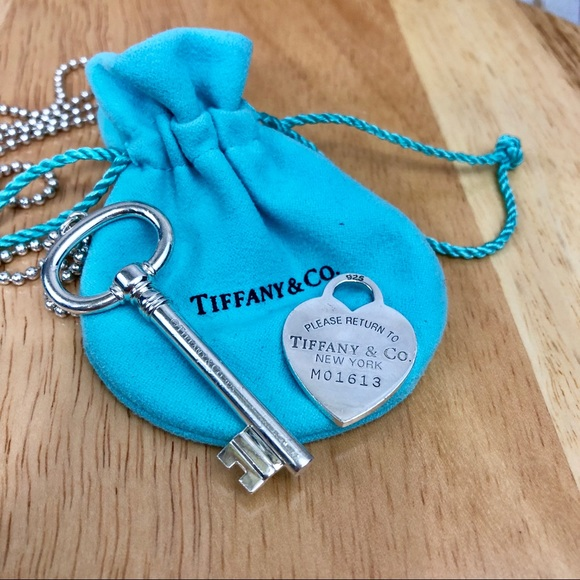 6bec20f117f0 Tiffany and Co. Heart Tag and Key Pendant. M 5bc10af6e944baaa0b096ce0